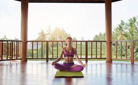 young-woman-meditating-in-lotus-yoga-pose-PAGL35E.jpg